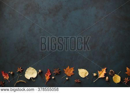 Autumn Background, Border Made Of Dried Yellow Leaves, Acorns And Pine Cones With Copy Space. Season