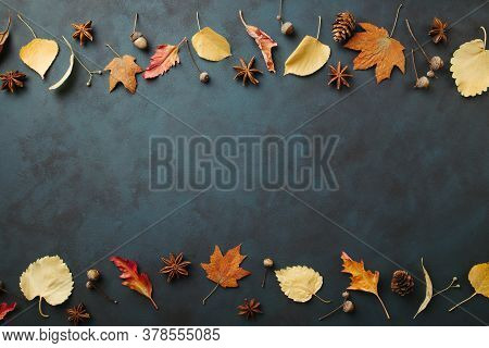 Autumn Season Abstract Background. Fall Yellow Leaves Frame On Dark Surface. Thanksgiving Day, Seaso