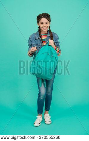 Bag Of Knowledge. Happy Kid Hold Heavy Backpack Blue Background. Knowledge Day. Back To School. Educ