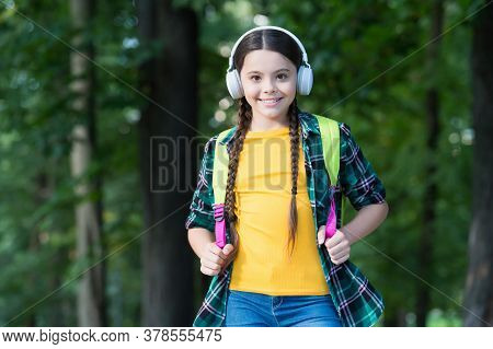 Plug It, Listen To It. Happy Child Listen To Music Natural Outdoors. Small Girl Wear Headphones In C