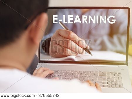 Anonymous Person Typing On Laptop With E Learning Digital Web Program Displayed On Screen. Online Ed