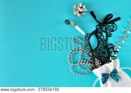 Various Accessories For Parties And Masquerades On A Light Blue Background
