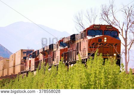 July 27, 2020 In Cajon Pass, Ca:  Freight Train With Four Locomotives Hauling Commerce From The La A