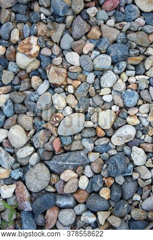 Small Multi-colored Pebbles Texture Background. Colorful Stones. Vertical Photo