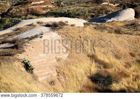 Sandstone Rocks Uplifted From The Earth On The San Andreas Fault At A Grassy Plain In The Arid Cajon