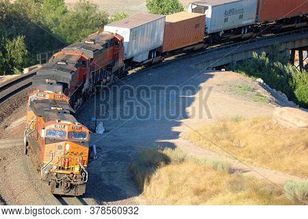 July 27, 2020 In Cajon, Ca:  Several Locomotives Hauling Rail Cars Up A Mountain Taken In The Cajon