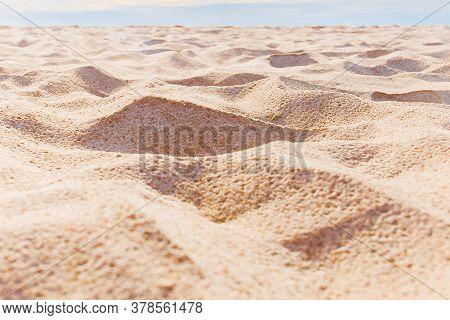 Close Up Empty Sandy Beach With Blue Sky.