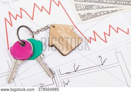 Keys With Home Shape, Currencies Dollars And Downward Graphs On Electrical Construction Diagrams Of