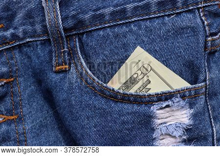 Banknote Money Twenty Us Dollar In The Pocket Of Blue Jeans. Concept Of Saving Money Or Finance.