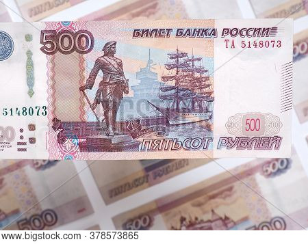 A Five-hundred-ruble Russian Note Hangs Over A Field Of These Same Banknotes. Showing Both Sides Of