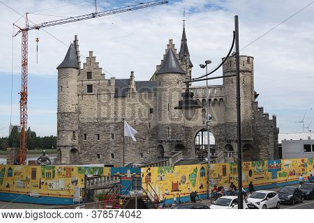 Antwerp, Belgium, July 19, 2020, Close Up Of The Fences And Castle Het Steen With Crane And Tourists