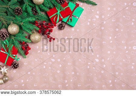 Christmas Corner With Green Fir Branches, Decorations And Christmas Gifts On A Art Paper Background.