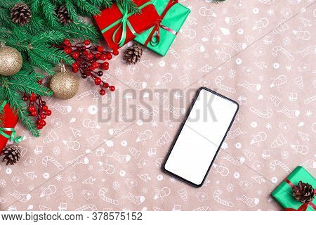 Mobile Phone In Christmas Decorations. Mockup Cell Phone With Blank Screen In Christmas Time. Christ