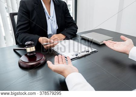 A Woman Lawyer Or A Judge Counseling Clients About Judicial Justice And Prosecution With Scales, Jud