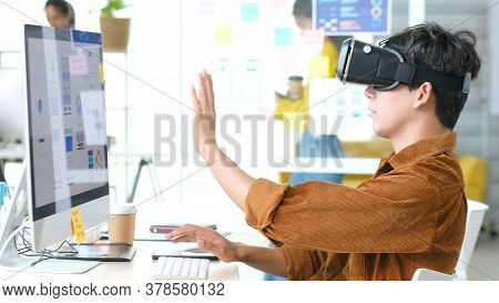 Vr Application Test, Asian Man With Virtual Reality Glasses Headset Touching Air During The Vr Exper