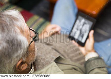 Senior Man Using An Ebook Reader