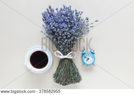 Lavender Bouquet, Coffe And Little Table Clock On Beige Background. Top View, Flat Lay,copy Space. M