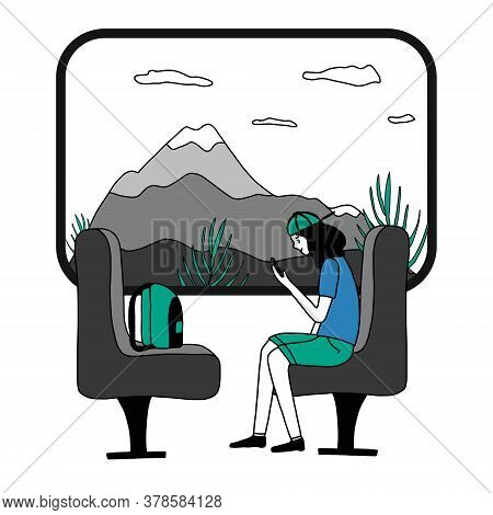 A Girl With A Smartphone Is Sitting In A Train Compartment At The Window. Train Ride Past The Mounta