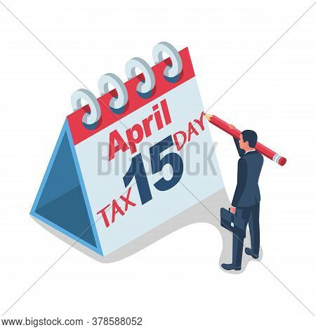 Tax Day Concept. Businessman Writes Tax Day On The Calendar. Human Filling Us Form. Business Income.