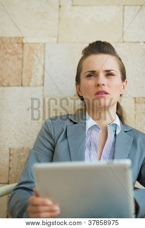 Thoughtful Business Woman Holding Tablet Pc