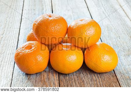 Tangerines. Fresh Tangerines On A Wooden Table