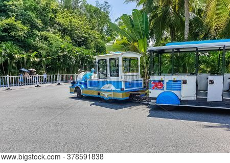 Sanya, Hainan, China - October 10: Vehicle In The Form Of A Blue Steam Locomotive For Carries Touris