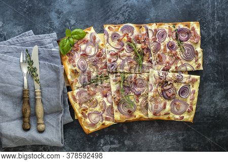 Traditional German Open Tart Flammkuchen - With Beacon, Red Onion, And Fresh Cream.