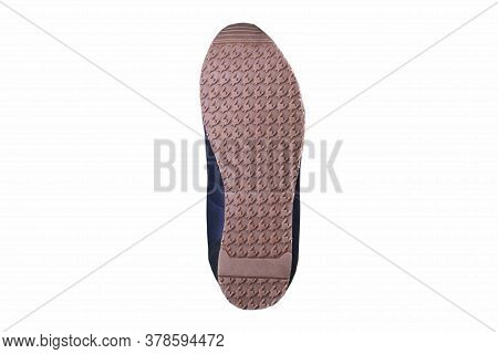 Rubber Sole Of A Shoe With A Geometric Pattern.