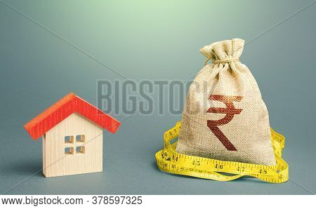 House And A Indian Rupee Money Bag. Mortgage Loan. Property Real Estate Valuation. Calculation Of Ex