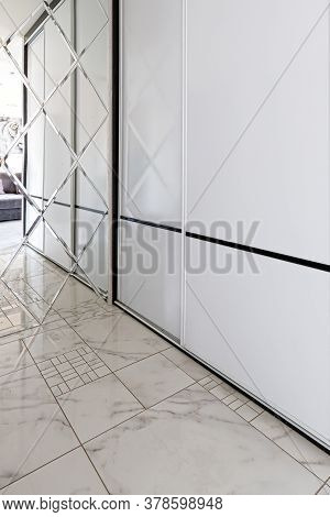 Modern Spacious Built-in Wardrobe In The Hallway. Interior Of A Modern Apartment. Spacious Hallway