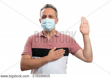 Oath Or Vow Gesture Made By Man Wearing Medical Mask As Stop The Flu Influenza Pandemic Promise Conc