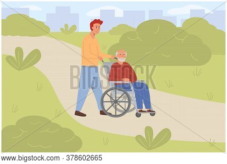 Young Son Social Worker Strolling With Old Man On Wheelchair In Green Park. Elderly Senior Age Disab