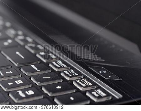 Fashionable Backlit Laptop Keyboard On Dark Background