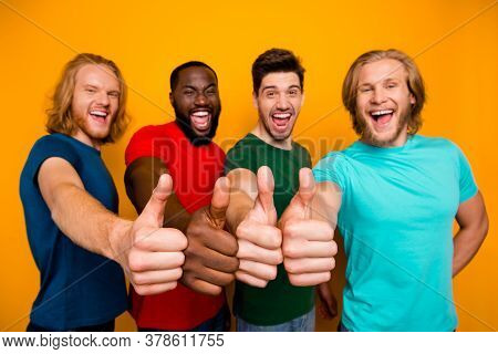 Portrait Of Energetic Fellows Four Man Enjoy Great Ideal Perfect Sale Ads Promotion Show Thumb Up We