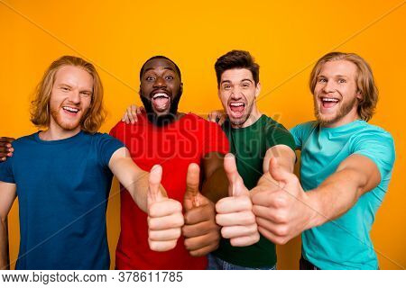 Portrait Of Energetic Buddies Four Men Show Thumb Up Symbol Enjoy Excellent Ideal Perfect Weekend Sa