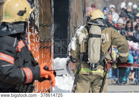 Firefighters Extinguishing Fire From Fire Hose, Using Fire-fighting Water-foam Barrel With Air-mecha