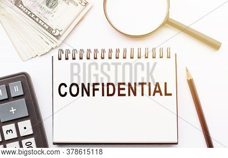The Word Confidential In Notebook On Office Table