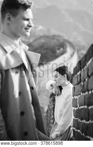 Beautiful Young Couple Posing At The Great Wall Of China