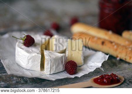 Camembert Cheese With Raspberry Sauce. Keto Snack. Selective Focus. Macro.