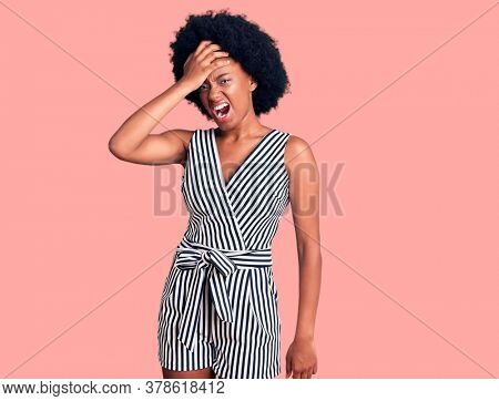 Young african american woman wearing casual clothes surprised with hand on head for mistake, remember error. forgot, bad memory concept.