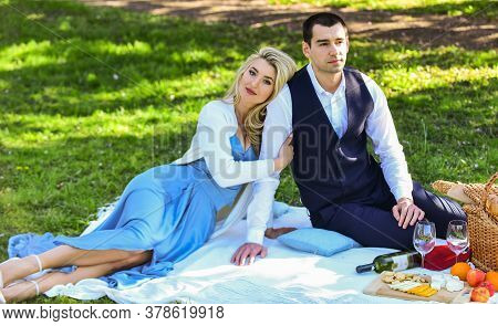 Spring Everywhere. Camping Concept. Happy Couple In Love. Woman And Man Lying In Park And Enjoying D