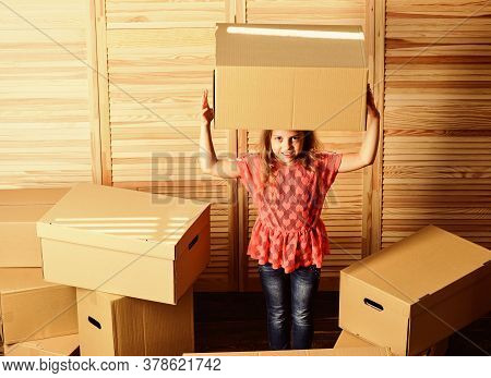 Box Package And Storage. Small Child Prepare For Relocation. Relocating Family Can Be Exciting, But