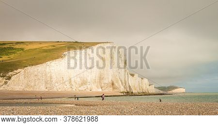 Dramatic White Cliffs And Shingle Beach At Cuckmere Haven, Seven Sisters Country Park, Brighton