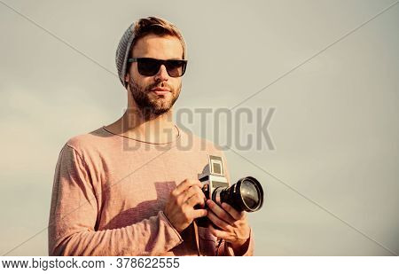 Hipster Reporter Taking Photo. Photojournalist Concept. Travel Blogger. Professional Photographer. H