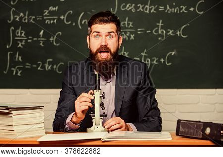 Eureka. Bearded Man Do Science Research. University Teacher In Research Laboratory. Using Microscope