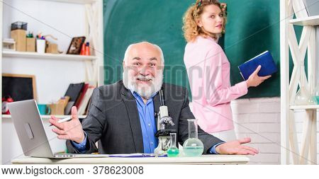 Funny Lesson. Mature Teacher With Beaker And Microscope. Back To School. Student Girl At Board. Stud