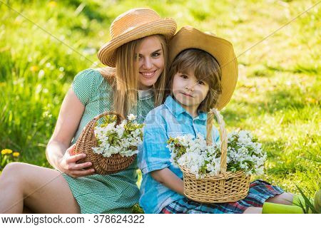 Spring Holiday. Wildflowers In Field. Motherhood Happiness. Cowboy Family Collecting Flowers In Bask