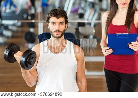 Young man training with his female personal trainer