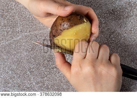 The Process Of Peeling Boiled Potatoes. Cooking Boiled Potatoes.