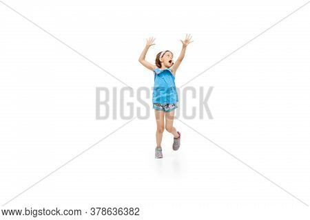 Happy Kids, Little And Emotional Caucasian Girl Jumping And Running Isolated On White Background. Lo